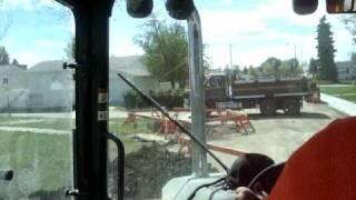 John Deere 410J Loading Dump Truck