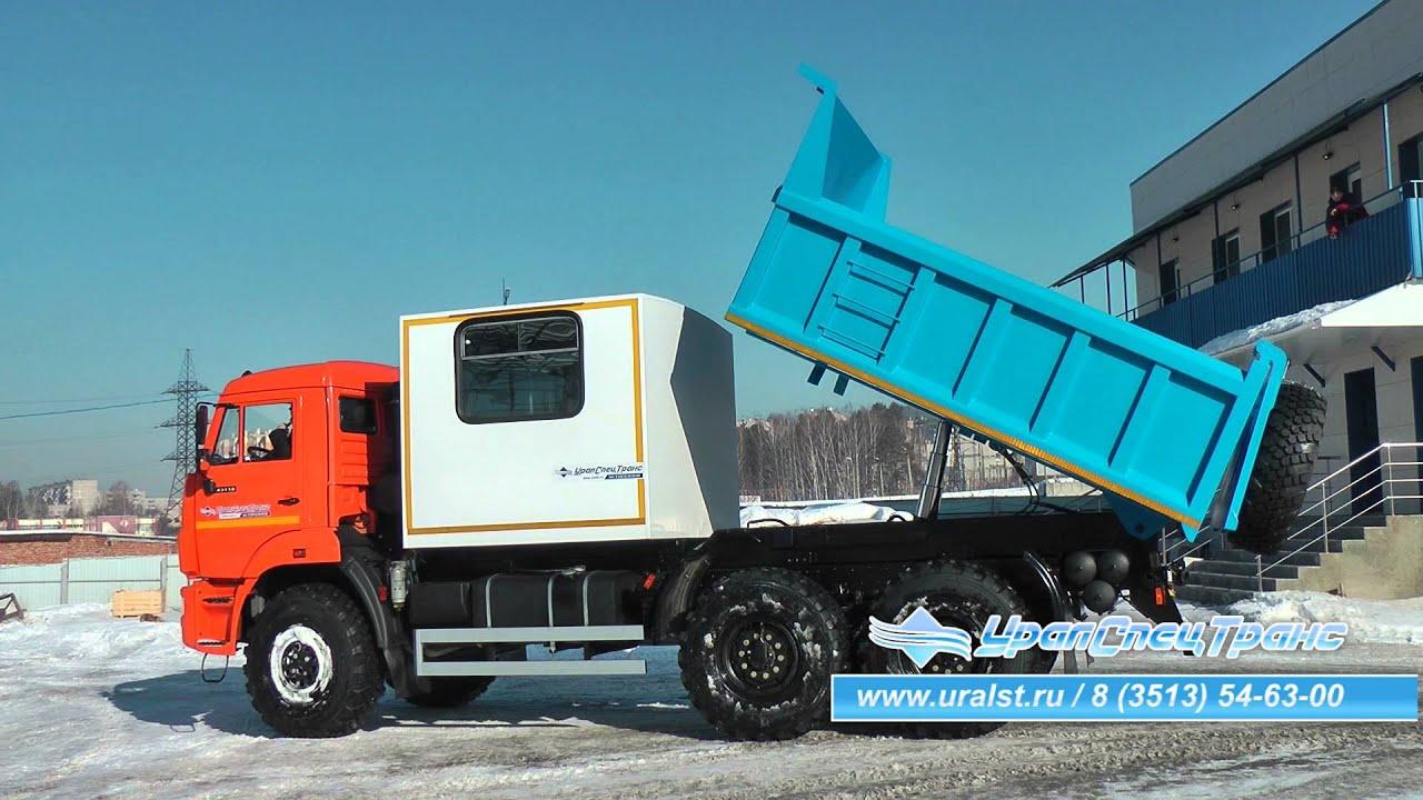 Спецавтомобиль КАМАЗ с грузовым отсеком и самосвальной платформой.