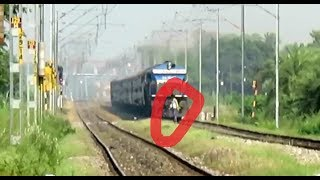 Silly Guy Walking In Front Of Running Train : Avadh Assam Express with SGUJ WDP4B : INDIAN RAILWAYS