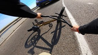 FULL SPEED BMX HILL BOMB CRASH INTO ONCOMING CAR (TIBIDABO)