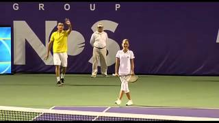 Andy Roddrick plays against a Model - Ballgirl at The Miami Tennis Cup 2012