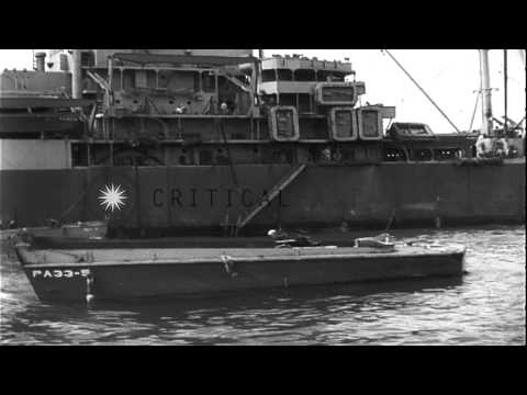 Rhino barges loaded from an LST (Landing Ship, Tank) during the Utah Beach consol...HD Stock Footage