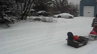 Kid riding Snowmobile