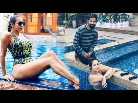 Malaika Arora Enjoying With Yoga teacher In Swimming Pool At Goa Pre New Year Party 2020 - YouTube