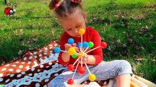 Jucarie Montessori   Dezvoltam imaginatia   Bilute Colorate si Betisoare din plastic