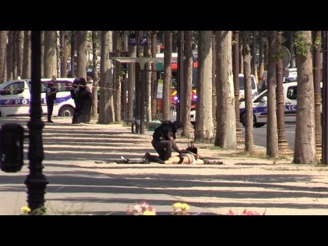 The dramatic moment a French police officer checks for a suicide bomb in Paris