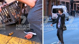 Knife-wielding man chased down Sydney street after woman stabbed