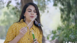 Pretty Indian girl cutely blowing soap bubbles and enjoying her leisure time