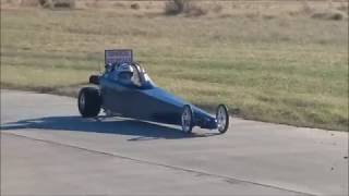 Little dude races his dragster
