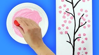 Up on the wall: Paint cherry blossom pictures with plastic bottles