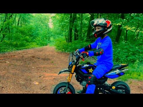 Den On Pocket Bike In Forest