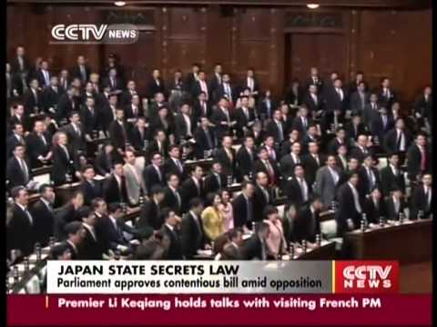 Japan state secrets law: parliament approves contentious bill amid opposition