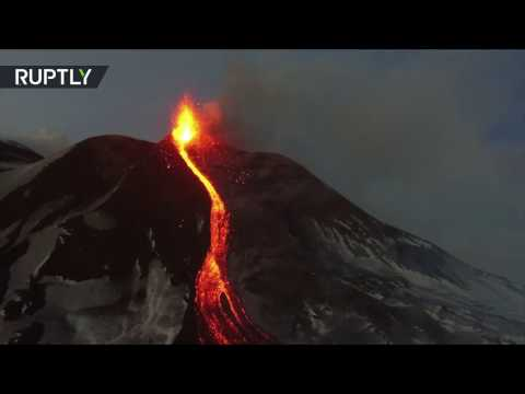Eruption fly-over: Mount Etna spewing lava & smoke, captured from drone
