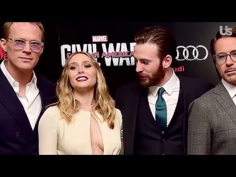 Chris Evans Can't Stop Staring at Elizabeth Olsen's Red Carpet Cleavage