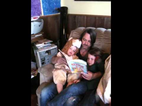 reading a very short book with a bear