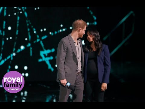 Duchess of Sussex makes surprise appearance on stage during Prince Harry's speech