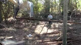 Caterpillar 225 loading rail on gooseneck trailer