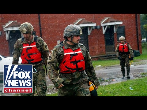 First responders work to rescue people trapped by Florence