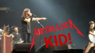 Dave Grohl invites a little boy (Collier) up on stage at the Kansas...