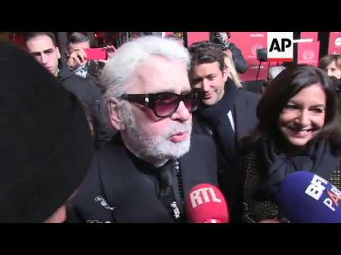 Karl Lagerfeld switches on Champs-Elysee Christmas lights