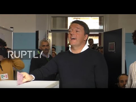 Italy: Renzi votes in referendum as his future hangs in the balance
