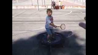 Jessie swinging the big racket