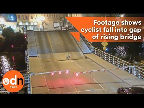 Shocking footage shows cyclist fall into gap of rising bridge
