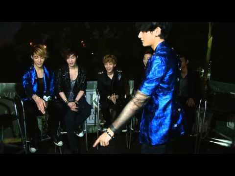 "EXO-M Tao ""kicking"" a water bottle off the MC's head"