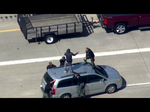 Police tackle suspect after chase on I-75 in Detroit