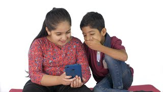 Little siblings watching funny videos on a smartphone - Invasion of technology in children's life