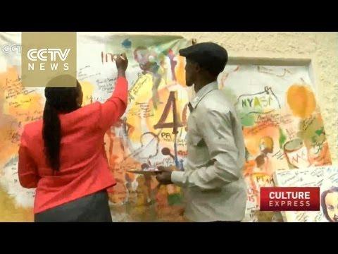 Uganda artist paints live at events