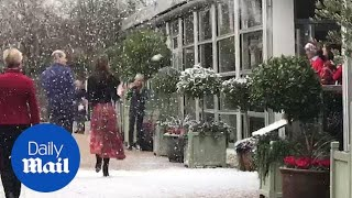 William and Kate pelted with fake SNOWBALLS at Christmas party