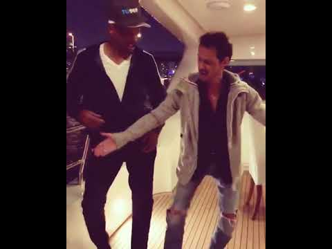 Marc Anthony teaching Will Smith how to dance salsa