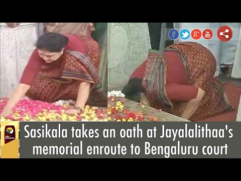 Sasikala takes 'Sabatham' at Jayalalithaa's memorial before leaving to Bangalore jail
