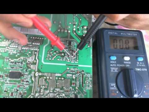 Medicin capacitor con multmetro digital en placa