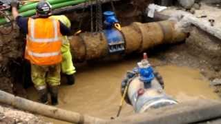 Cutting ductile water main with chain cutter