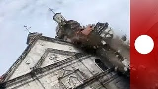 Amateur video: Quake tears down bell tower of oldest church in Philippines