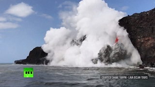 Rare footage: 'Firehose' spews lava into Pacific ocean off Hawaii Island