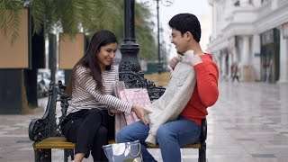 Young boyfriend girlfriend exchanging valentine's special gifts with each other