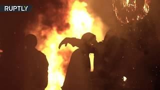 Spaniards set brooms ablaze, dance around fire, amid Los Escobazos festival