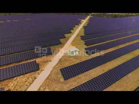 aerial flying above large power plant using renewable solar energy nk0umfka