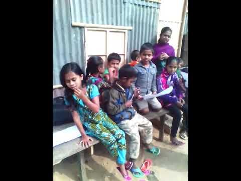 Mousiur Sir taking Slum Children's Attendance