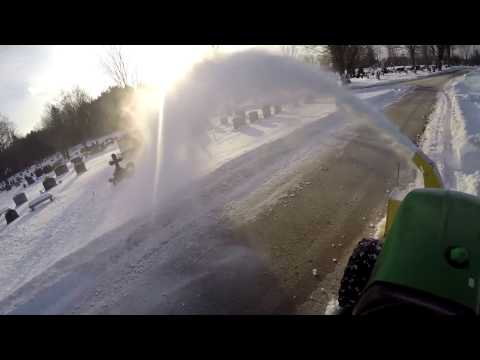 """Blowing snowbanks with the 47"""" front mount blower with the DEERE 2032R"""