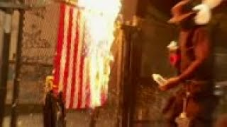 Portland protesters burn US flags, police arrive