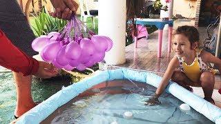 ENCHI UMA PISCINA COM BEXIGAS - 100 bexigas de água em 1 minuto