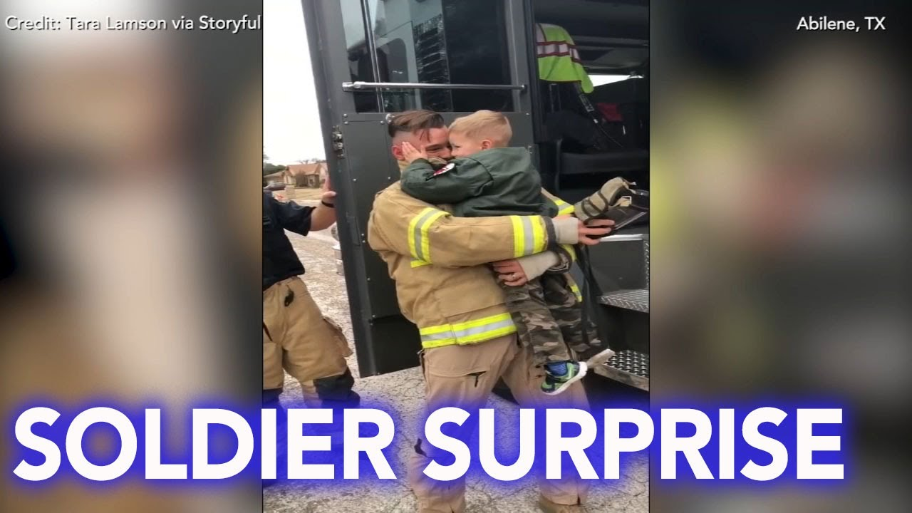 Soldier dresses as firefighter to surprise young son