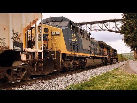 CSX ES40DC lead diesel pair under Poughkeepsie-Highland bridge on Hudson river (1 of 3)