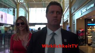 Ivanka Trump arrives at the airport surrounded my Secret service agents