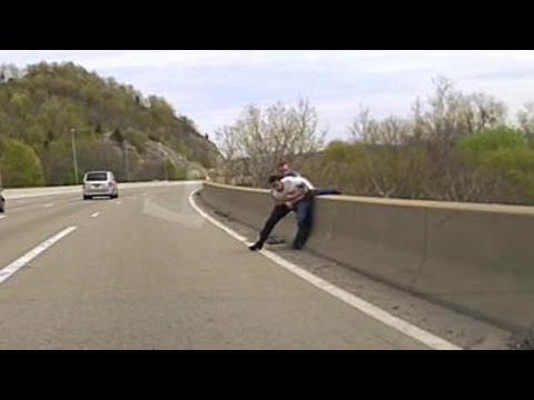 Quick-Thinking Police Officer Saves Man Trying To Jump Off Bridge
