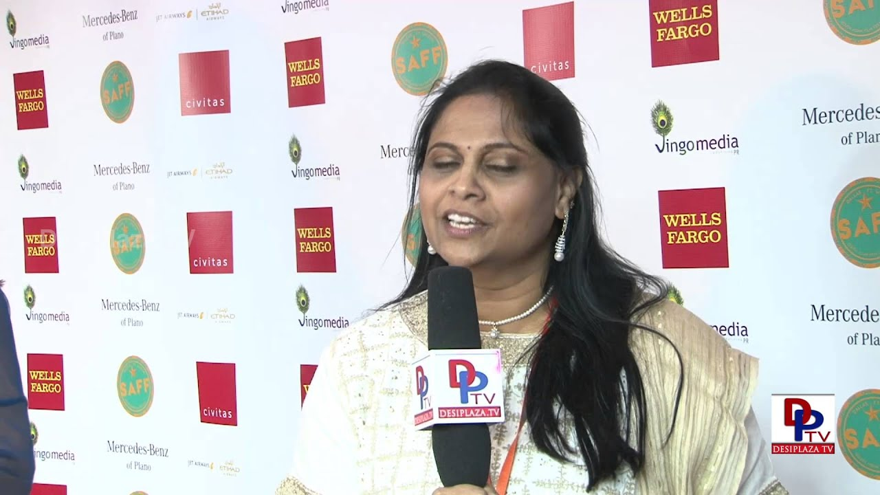Anu Benakatti giving intro of South Asia Film Festival in Dallas,Texas.
